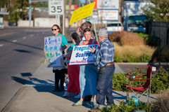 Planned Parenthood Eugene Oregon. EUGENE, OR - OCTOBER 4, 2015: Anti-abortion protesters target pedestrian and vehicle passersby in front of Planned Parenthood royalty free stock images