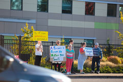 Planned Parenthood Eugene Oregon. EUGENE, OR - OCTOBER 4, 2015: Anti-abortion protesters target pedestrian and vehicle passersby in front of Planned Parenthood stock images