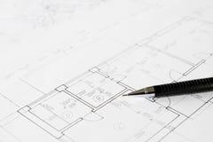 Plannen en zwart potlood Stock Foto's