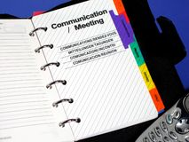 Planner. /organizer opened to communication/meeting section Royalty Free Stock Image