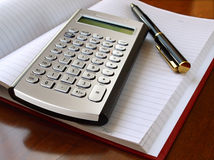 Planner with calculator and pen Stock Image