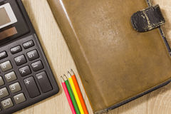 Planner with Calculator and pencils Stock Photos