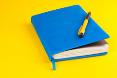 Daily planner with colored bookmarks. Blue Daily planner with colored bookmarks. yellow background Royalty Free Stock Image