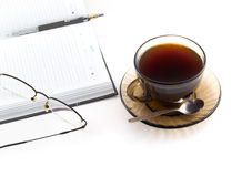 Daily planner and cup of coffe Stock Photos