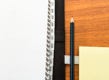 Planner Diary with Pencil and Paper Note. Planner Diary with Pencil and a Paper Note on Wood Background Stock Photos