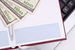 Planner, Dollars and laptop Royalty Free Stock Photos