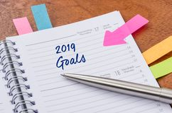 Daily planner with the entry 2019 Goals stock photography