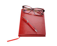 Daily planner with eyeglasses and pen red color Stock Photo
