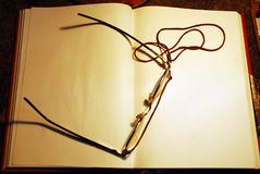 Daily planner with glasses. On work table Stock Photography