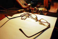 Daily planner with glasses. On work table Stock Images