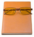 Daily planner with glasses isolated on white. Background Royalty Free Stock Photo