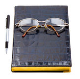 Daily planner with glasses and pen Stock Photos