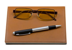 Daily planner with glasses and pen Stock Image