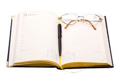 Planner with glasses and pen on white Stock Image