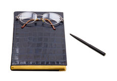 Planner with glasses and pen on white Royalty Free Stock Photo