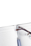 Planner with glasses on a white background isolate Stock Photography