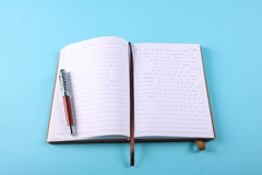 Planner notebook in blue pastel background Stock Photo