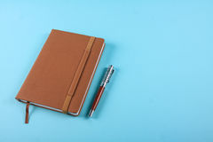 Planner notebook in blue pastel background Stock Photography