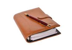 Daily planner with pen Stock Image