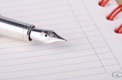 Daily planner with pen. Close up Royalty Free Stock Photography