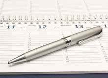 Planner with a pen. Planner with a silver pen stock images