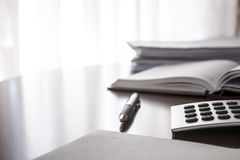 Planner with  pen and calculator. On the table Royalty Free Stock Photography