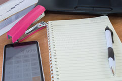 Planner with pen and calculator on the table Royalty Free Stock Image