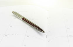 Daily planner with pen. Close up daily planner with pen Royalty Free Stock Image