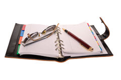 Planner, pen and eyeglasses Stock Photos