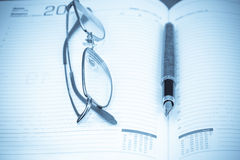 Planner, pen and glasses Royalty Free Stock Photo