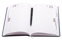Daily planner with pen isolated on white Stock Images
