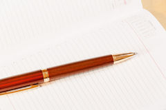 Daily planner with pen on the table Royalty Free Stock Photos