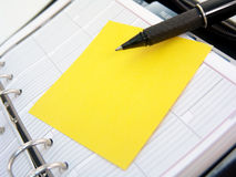 Planner, sticky note and pen Stock Image
