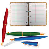 Planner with three pens Royalty Free Stock Photos