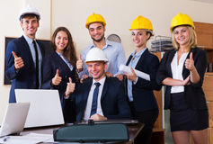 Planners with helmets in architecture bureau Stock Images