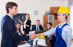 Planners with helmets in architecture bureau Royalty Free Stock Images