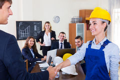 Planners with helmets in architecture bureau Royalty Free Stock Photography