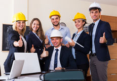 Planners with helmets in architecture bureau. Professional planners with helmets posing at architecture bureau Stock Photo
