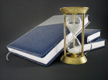 Planners and sandglass stock photo