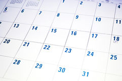Planning. Calendar page with dates in blue and white Stock Photos