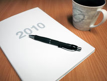 Planning 2010. The 2010 year planner with pen and coffee Royalty Free Stock Photo