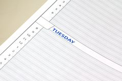 Daily Planning. Close up of a daily planning schedule sheet showing the day as Tuesday Royalty Free Stock Image