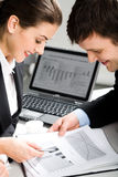 Planning. Image of two business people planning a new project in a working environment Royalty Free Stock Images