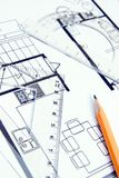 Planning. A pencil, protractor and setsquare on top of a floor plan royalty free stock photo