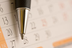 Planning. Future tasks on a calendar using a ballpoint pen Royalty Free Stock Images
