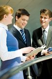 Planning. Photo of confident business people planning work at corporate meeting Royalty Free Stock Photo