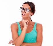 Planning brunette woman with green tank top Royalty Free Stock Photography