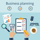 Planning business. Hands businessman on table, planning a business plan. Strategy development. Finding solutions, diagrams, calculation, financial analysis Royalty Free Stock Images