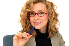 Planning business schedule. Thoughtful, young businesswoman holding a pen royalty free stock photos