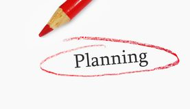 Planning circle. Red pencil closeup and Planning text circled Stock Image